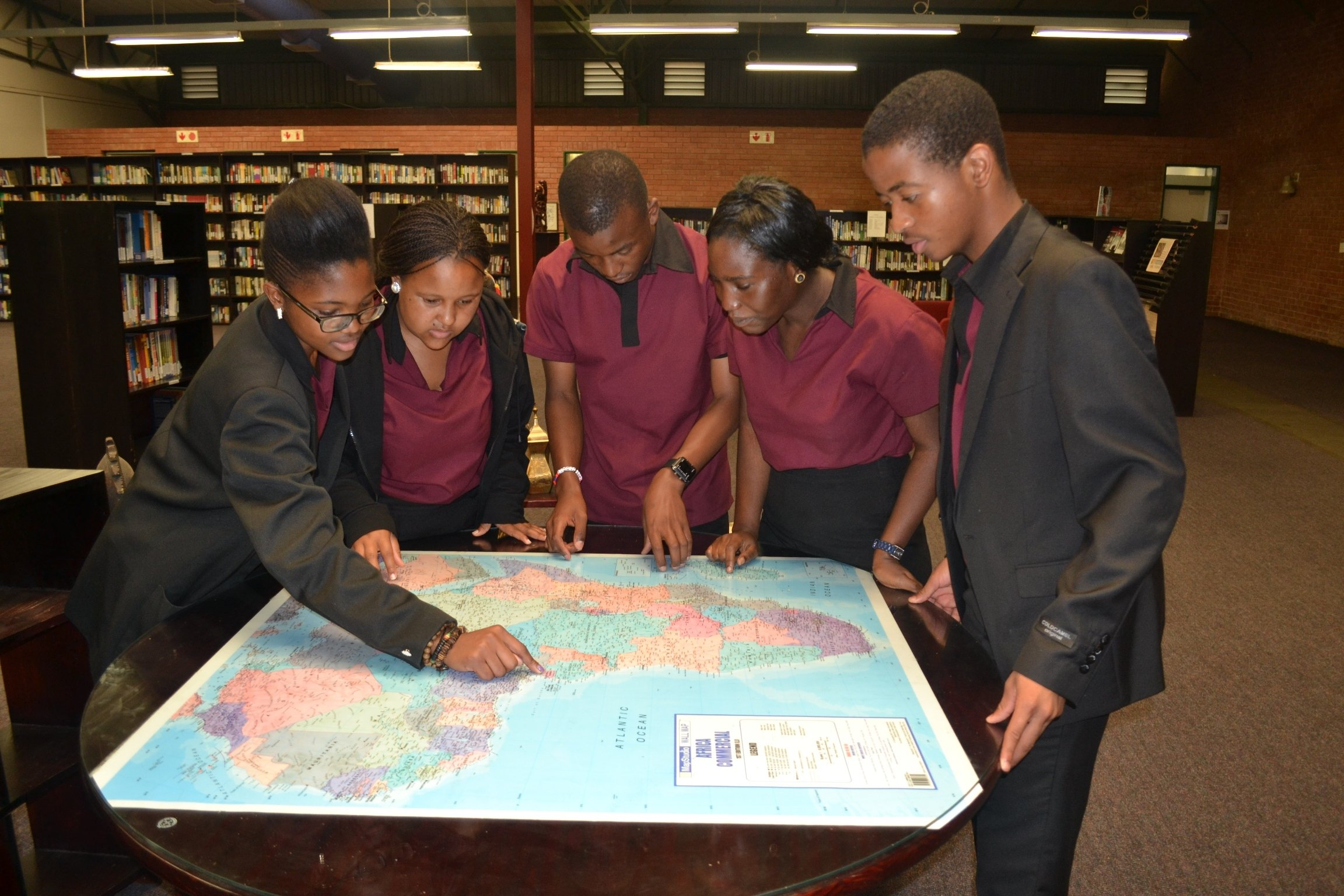 ALA students look at map of Africa
