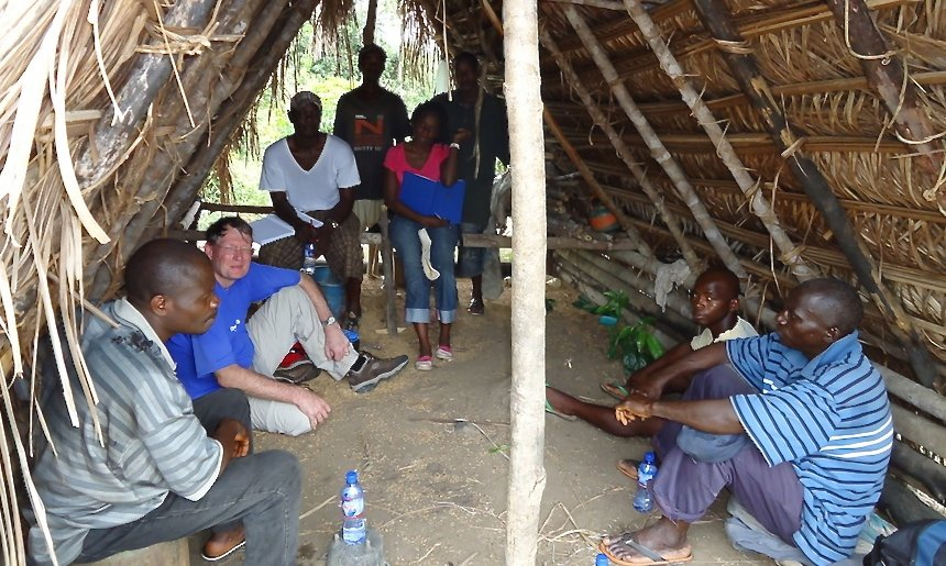 Mark visiting a home in Bong County, Liberia