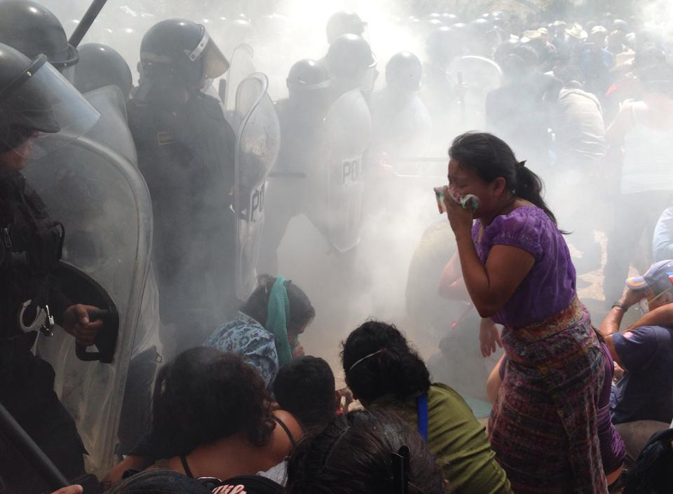 Police use tear gas on mine opponents