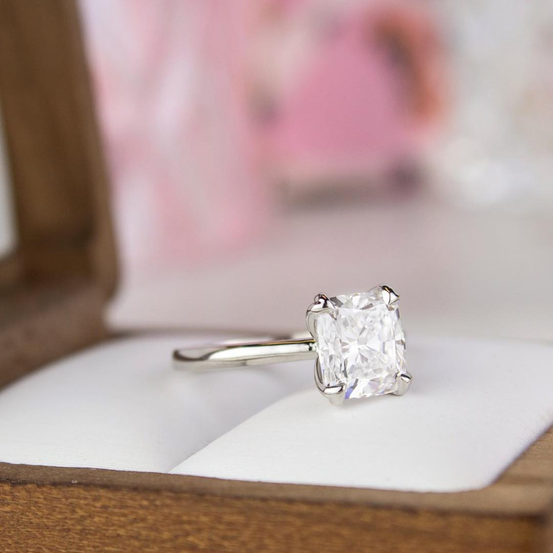 b92e23ad4 A diamond solitaire is the quintessential engagement ring. Although other engagement  ring settings rise and fall in popularity, a solitaire ring is a ...
