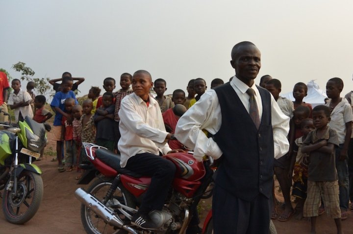 Teachers with their motorcycles get a feel of the atmosphere before the launch
