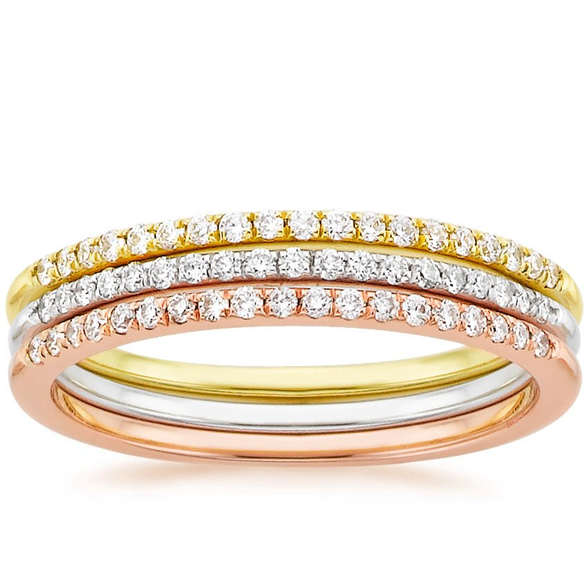 Whisper diamond ring stack in rose gold, yellow gold, and white gold