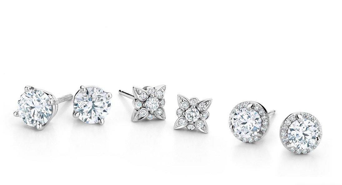 Three pairs of diamond earrings