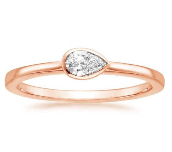 rose gold pear diamond bezel ring