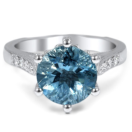 Embellished Aquamarine Ring with Decorative Crown, top view