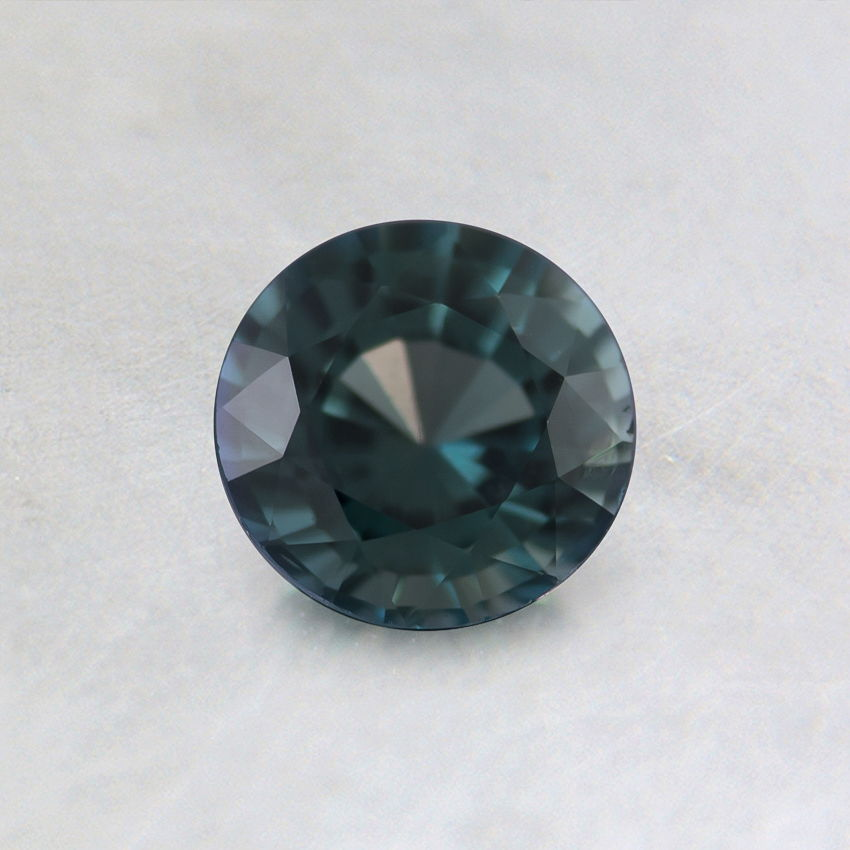 5mm Unheated Teal Round Sapphire, top view