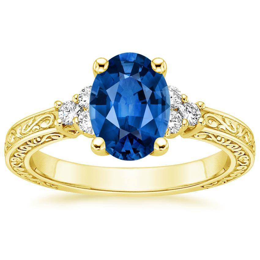 Sapphire Adorned Trio Diamond Ring in 18K Yellow Gold with 8x6mm Oval Blue Sapphire