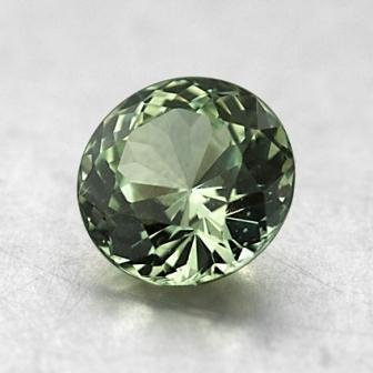 6.8mm Unheated Light Green Round Sapphire, top view