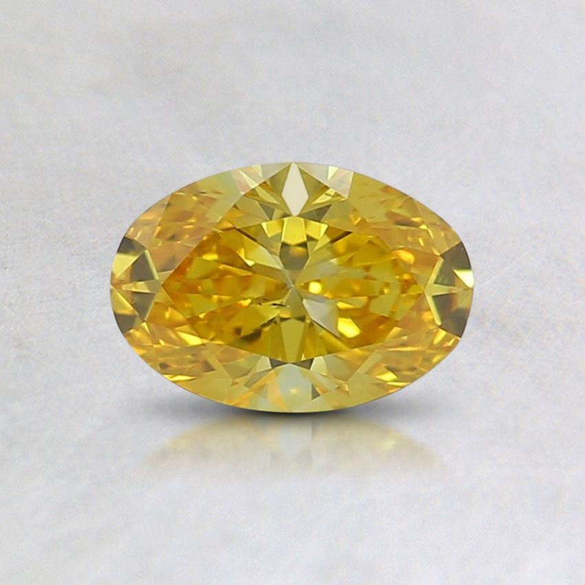 0.52 Ct. Fancy Vivid Orangy Yellow Oval Lab Created Diamond