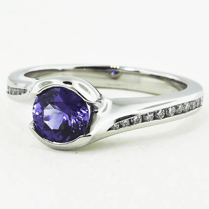 Platinum Sapphire Cascade Ring with Channel Set Diamond Accents