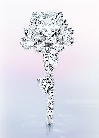 Intricately detailed floral inspired diamond engagement ring.