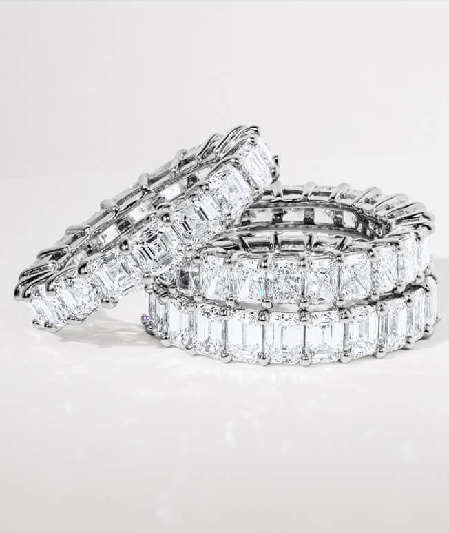 Stack of luxe diamond eternity rings.
