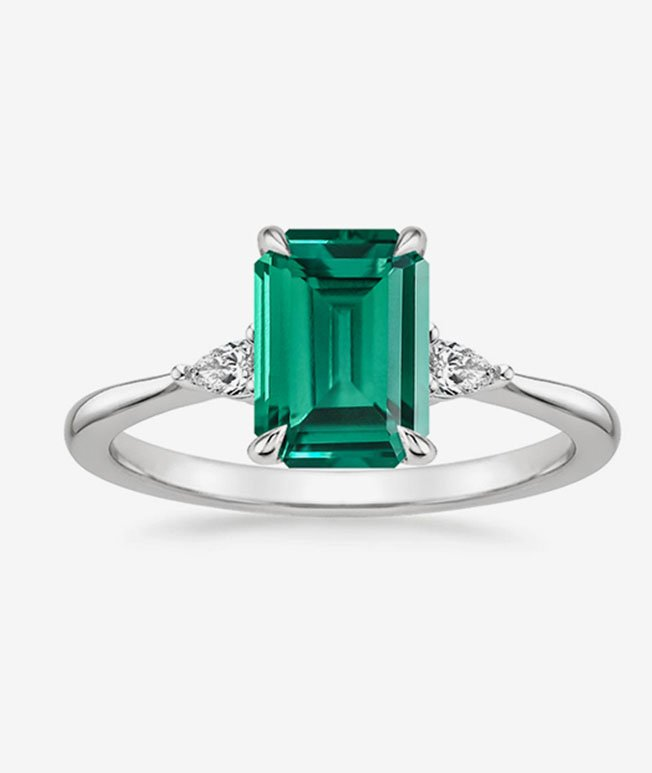 20 Year - Emerald engagement ring with diamond accents