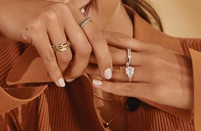 Model wearing stackable diamond fashion rings