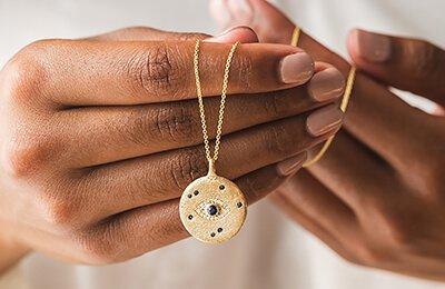 Unique yellow gold medallion necklace