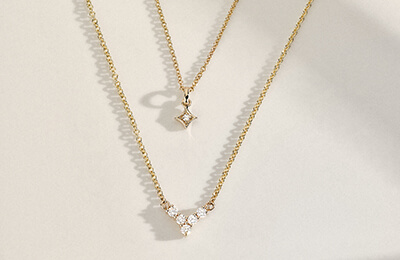 Layered yellow gold necklaces