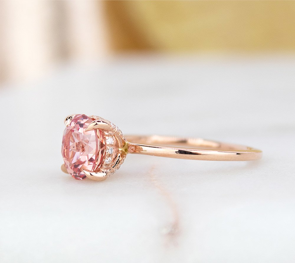 Rose gold engagement ring with pink sapphire and surprise diamond details